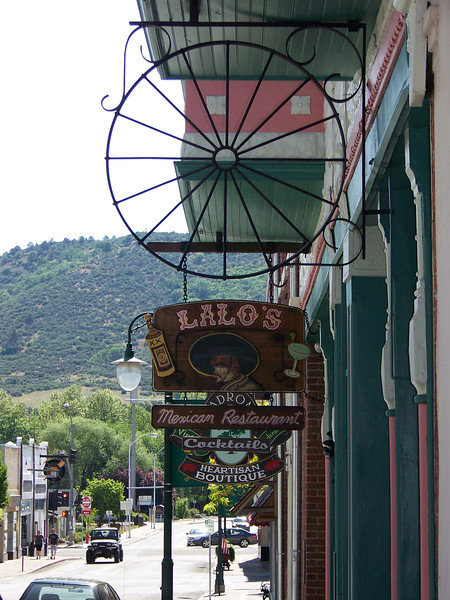 Some of the shop signs hanging over the sidewalk on West Miner Street.<br /> [Yreka, CA]
