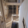 from office looking down future stairs to hallway below and bathroom