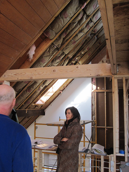 Master bedroom looking towards living room overlook with ceiling partially removed and old insulation