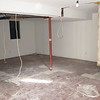 Basement with bathroom to right.  Utility room to left.  Bedroom wall and bedroom closet removed.