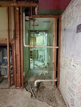 Finishing demolition of the old backstage bathroom.