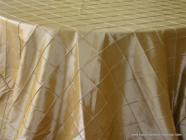 "4"" Pintuck Taffeta - Gold Available Linens: 132"" Round"