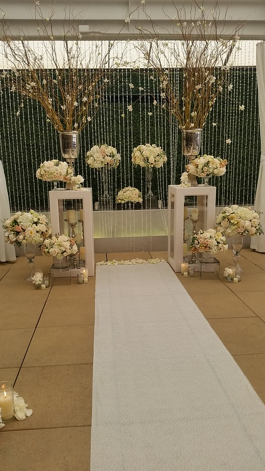 We have 2 of these glass pane pedestals that are great with candle stands and petals inside