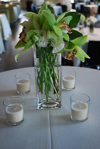"""I have (146) of these 7"""" skinny square vases.  They are cute alone as used on this bar high table or coupled with other ones for a complete centerpiece."""