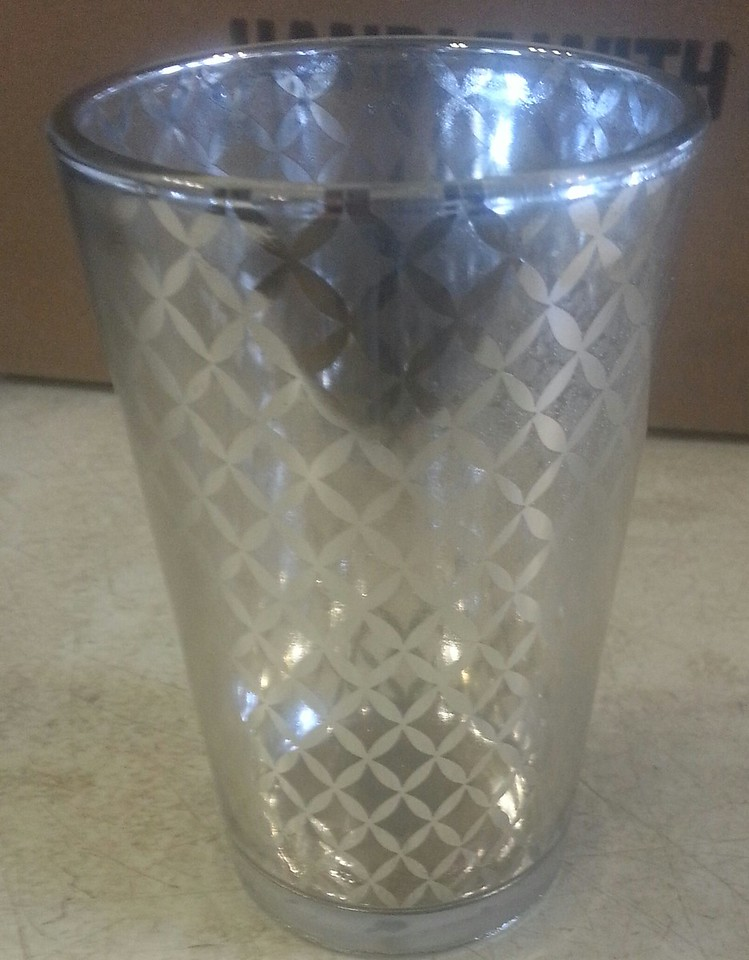 silver lattice oversized votive holder....This can also be used as a vase