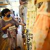KRISTOPHER RADDER — BRATTLEBORO REFORMER<br /> Brenda Knock, owner of The B's Nest, on Elliot Street, in Brattleboro, Vt., hangs up a baby onesie while opening for the first time on Monday, May 18, 2020, after being closed because of the COVID-19 pandemic.