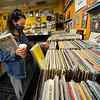 KRISTOPHER RADDER — BRATTLEBORO REFORMER<br /> Samantha Rubin, from New Jersey, flips through records at Turn It Up, on Main Street, in Brattleboro, on Monday, May 18, 2020.