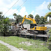 Old residential neighborhood home being demolished.