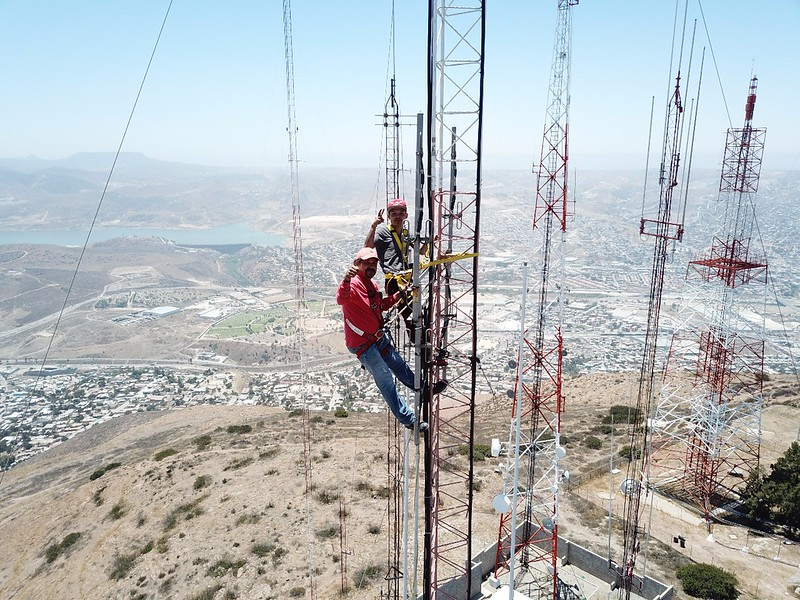Towers climbers at 150 foot level - drone view