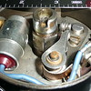 "ELECTRONIC IGNITION: 1 of 4.  (Before Starting.)  Richard Coulombe (44) converted his car to electronic ignition recently and writes:  ""The ""IGNITOR"" electronic system for the '29 Buick is: PEX 1168 LS N6.  It fits easily inside distributor housing, using same point hold down screw. I added the condenser hold down screw to seat the plate perfectly flat."