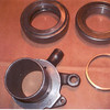 By Gari Blesi (26 & 27):  When I purchased a release (throwout) bearing, I was disappointed to find a spacer ring included to make up for the difference in thickness between the original and the replacement bearing.  Pic. 1: Orig. bearing, with bearing sleeve, on left.  Replacement, with spacer ring, on right.