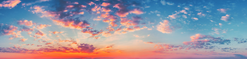 Panorama Sunset Sunrise Sky Background. Natural Bright Dramatic Sky In Sunset Dawn Sunrise. Yellow, Blue And Pink Colors
