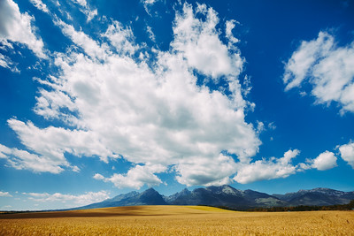 White bright clouds in the clear blue sky. Tatras.