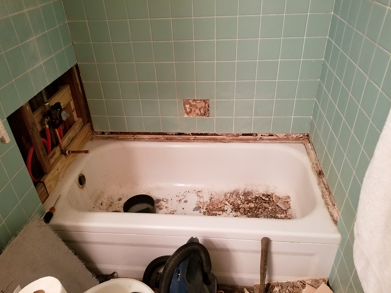"Decided that I'll be adding a white trim around the bottom of the walls at the tub, as the old pink pieces were cracked and coming off the wall. Googled the hell out of various ""mid century"" tile suppliers. Didn't find a single vendor that had anything even close. Also since it's all torn up, the bath is getting a new 36"" vanity, new faucet, a new toilet and glass door enclosure! Stay Tuned !"