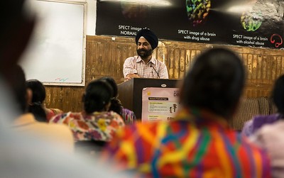 Dr. Bhatia addressing a group thearpy session for addicts and their families