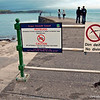 That's my brother standing right at the end of this grotty pier.<br /> <br /> Criccieth, North Wales.