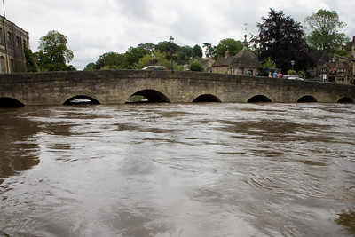 Town Bridge and the river Avon at Bradford-on-Avon near to bursting its banks.