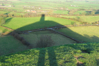 From the top of Glastonbury Tor.  You can tell it's not festival time - the weather is fine.  I read today about how you should avoid getting your own shadow in a photo.   That's one rule I don't mind breaking.  (Clue the two leg-shaped shadows at the bottom are me - the pointy shadow at the top isn't.