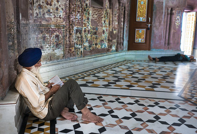 The fading murals inside the neighboring Gurudwara Baba Atal Saheb