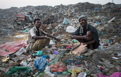 Bengali migrants in Bhagtanwala garbage dumping site take a break from work.