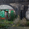 old railway arches now boarded up, derelict