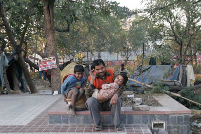 Family living in a tent placed in a park, just next to the under construction metro, where he works in daily time. New Delhi