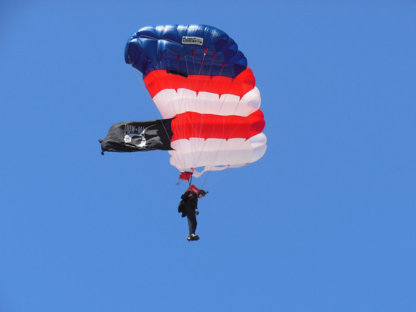Dan Cook of Loveland made his 3000th and final parachute jump as a member of the All-Veterans Parachute team. After landing on North Avenue Beach in Chicago, he proposed to his girlfriend, Leah Angott. (submitted photos)