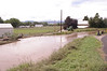 Water spills over the ditch Friday, Sept. 13, 2013, near the Hillcrest at Fifth Street and Douglas Avenue in Loveland. (Loveland Reporter-Herald/Jeff Stahla)