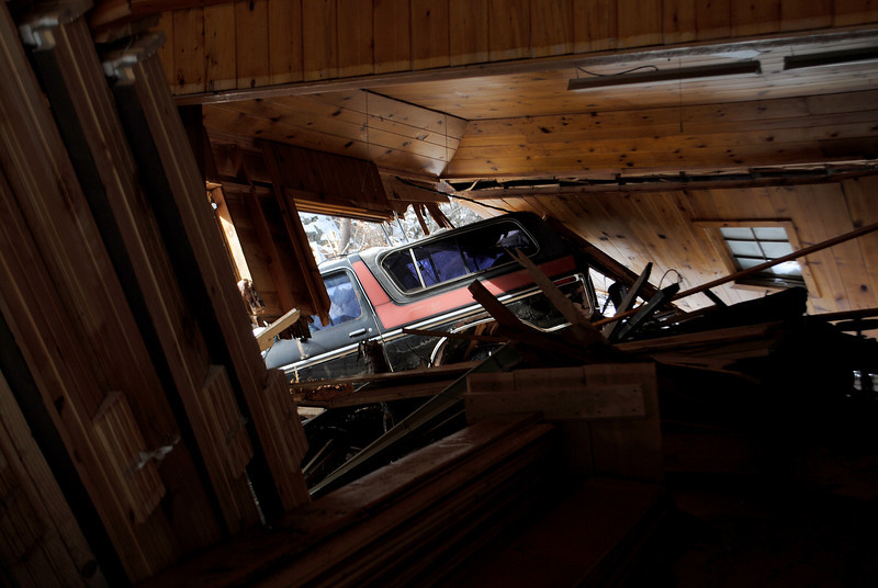 Truck inside town hall at Glen Haven on Sunday Nov. 24, 2013. Many vehicles where taken by the strong waters and ended up inside buldings. (Photo by Lilia Munoz/ Loveland Reporter-Herald)