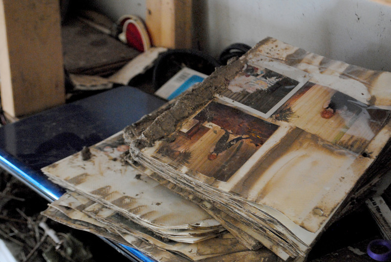 Photo albums destroyed by the flood inside Patrick Losee's home near Glen Haven Sunday Nov. 24, 2013.  (Photo by Lilia Munoz/ Loveland Reporter-Herald)