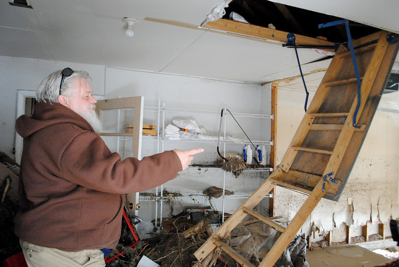 Patrick Losee looks over the damage caused by the flood to his home by near Glen Haven Sunday Nov. 24, 2013. Him and his girlfriend had to hide in the attic when his home flooded with about 8 feet of water. (Photo by Lilia Munoz/ Loveland Reporter-Herald)