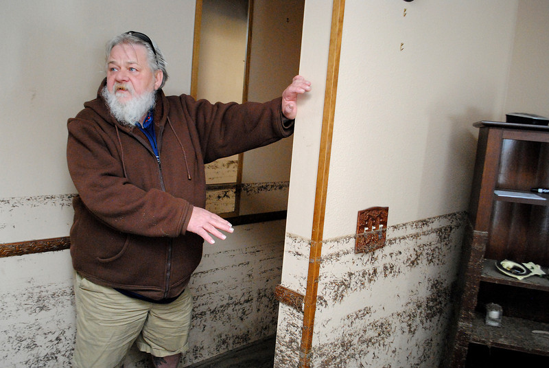 Patrick Losee talks about the water level inside his home during the September flood near Glen Haven Sunday Nov. 24, 2013.  (Photo by Lilia Munoz/ Loveland Reporter-Herald)