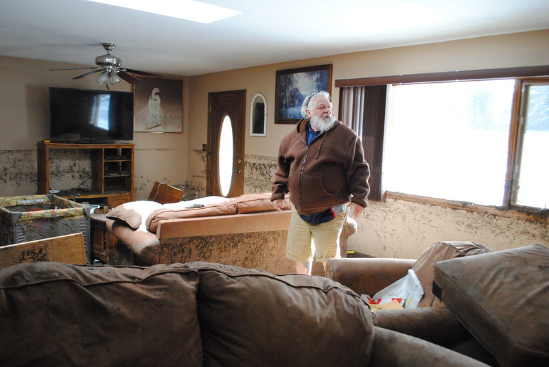 Patrick Losee stands in what used to be his living room at his home near Glen Haven Sunday Nov. 24, 2013.  (Photo by Lilia Munoz/ Loveland Reporter-Herald)