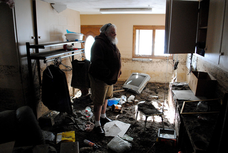 Patrick Losee looks over the damage caused by the flood to his home near Glen Haven Sunday Nov. 24, 2013.  (Photo by Lilia Munoz/ Loveland Reporter-Herald)