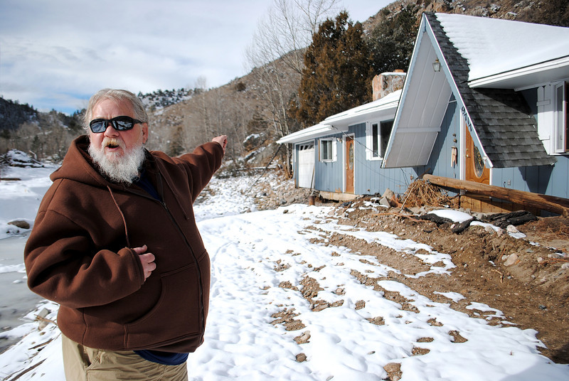 Patrick Losee stands outside his home near Glen Haven Sunday Nov. 24, 2013. His home was detroyed by the September flood, him and his girlfriend had to escape out a skylight with the help of local firefighters. (Photo by Lilia Munoz/ Loveland Reporter-Herald)