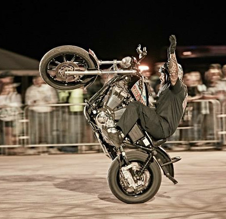 "Tony Jones - aka King Tony - does a wheelie in a ""Busted Knuckles"" stunt tour. He and Eric Rocks will be performing their skills on Harley Davidson motorcycles at Thunder in the Rockies Sept. 4-7."