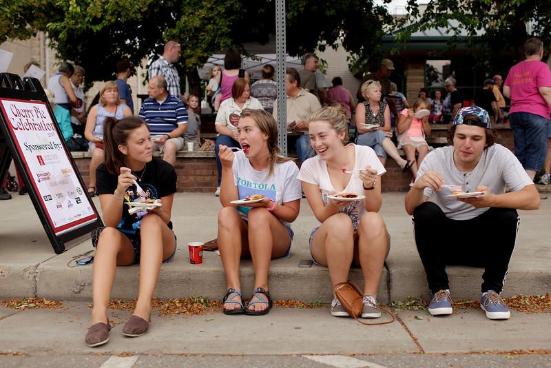 Haaley Gillen, Ally Mattson, Arryn Mattson and Ethan Mattsen enjoy pie curbside at a cherry pie celebration outside the Loveland Museum Gallery on July 18, 2015 in Loveland, CO. (Photo by Trevor L Davis/Loveland Reporter-Herald)
