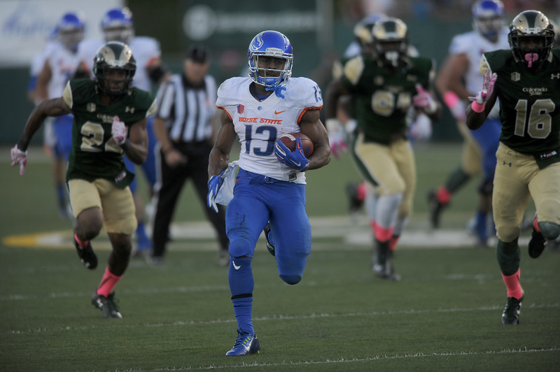 Jeremy McNichols (13), running back for Boise State, is chased don by Colorado State's Nick Januska (22), left, and Trent Matthews (16) in the first half on Saturday, Oct. 10, 2015 in Fort Collins.(Photo by Trevor L Davis/Loveland Reporter-Herald)
