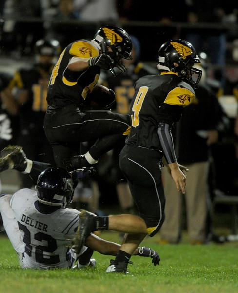 Matt Berg, wider receiver for Thompson Valley, jumps over Mountain View's  Austin Delier on Friday, Oct. 2, 2015 in Loveland. (Photo by Trevor L Davis/Loveland Reporter-Herald)
