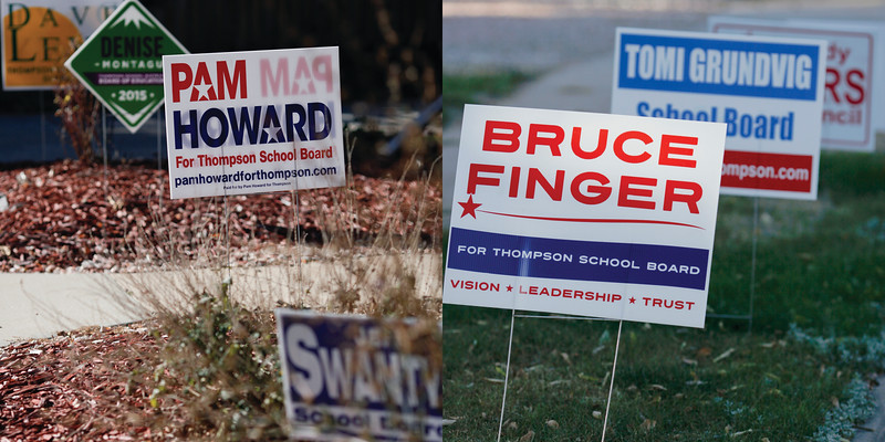 Signs for Thompson School Board candidates on display in downtown Loveland on Wednesday, Oct.14, 2015. The first campaign finance reports were due Tuesday. (Photos by Trevor L Davis/Loveland Reporter-Herald)