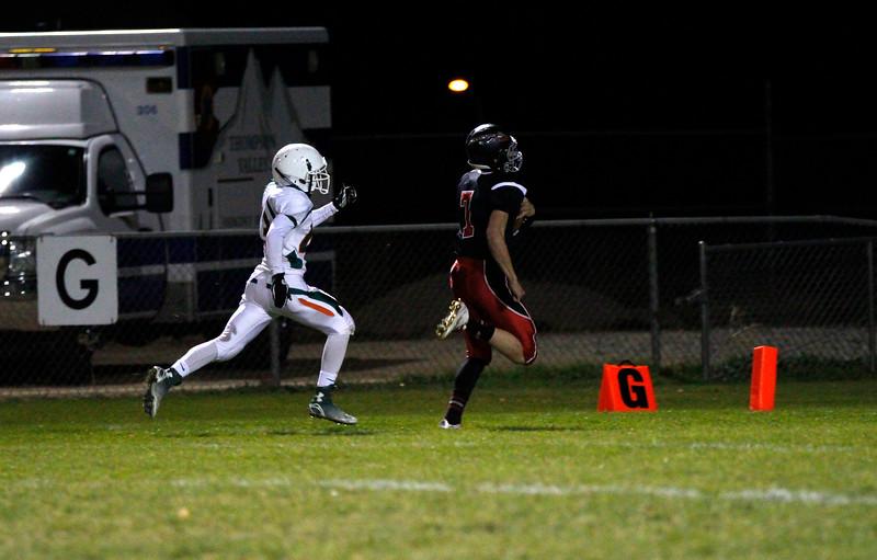 Quarterback Ayden Eberhardt runs for his first touchdown of the night on Friday 30,2015. (Photo by Matthew Gaston/Loveland Reporter-Herald)