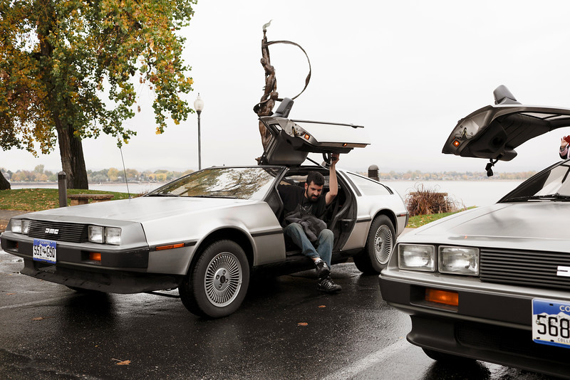 Michael Siegel, 26 year old from Mead, gets out his DeLorean at the South Shore Parkway at Lake Loveland on Wednesday, Oct. 21, 2015. Siegel's Delorean is an homage to the 80's classic, Back to the Future. He even has a replica of a Flux Capacitor, the fictional device that made time-travel possible in the film. (Photo by Trevor L Davis/Loveland Reporter-Herald)