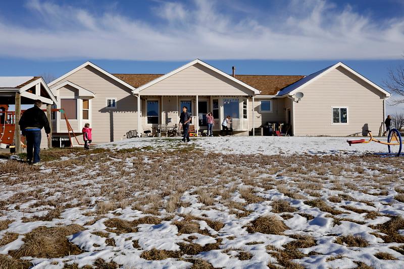 From Left, Joe, Ava, Eli, Ronda, Rebeccah and Hannah playing in their backyard on Sunday, Dec. 13, 2015 in Loveland. (Photo by Trevor L. Davis/Loveland Reporter-Herald)