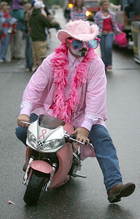 Tray Huggins, with Tough Enough to Wear Pink, rides around on a miniature motorcycle.