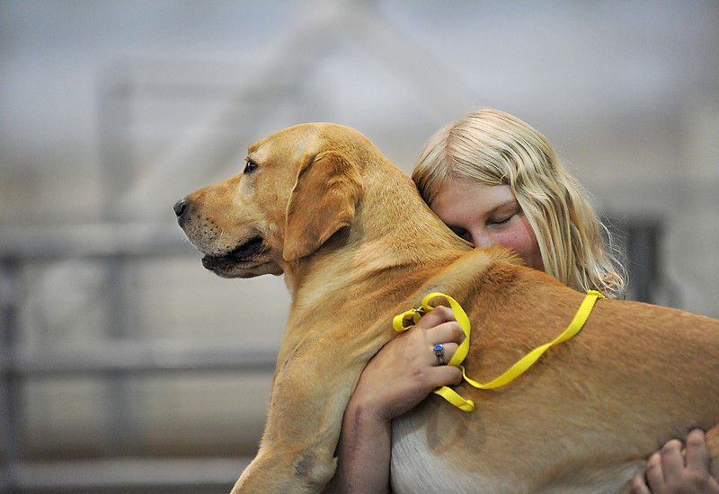 "Denise Moberg, 18, shares a moment with Dakota before competing in the 4-H Dog Agility Show in the Ranchway Feeds Indoor Arena at The Ranch. Moberg, who has been competing for five years, says she does it for Dakota, ""he'd be pretty bored if I didn't do 4-H."""