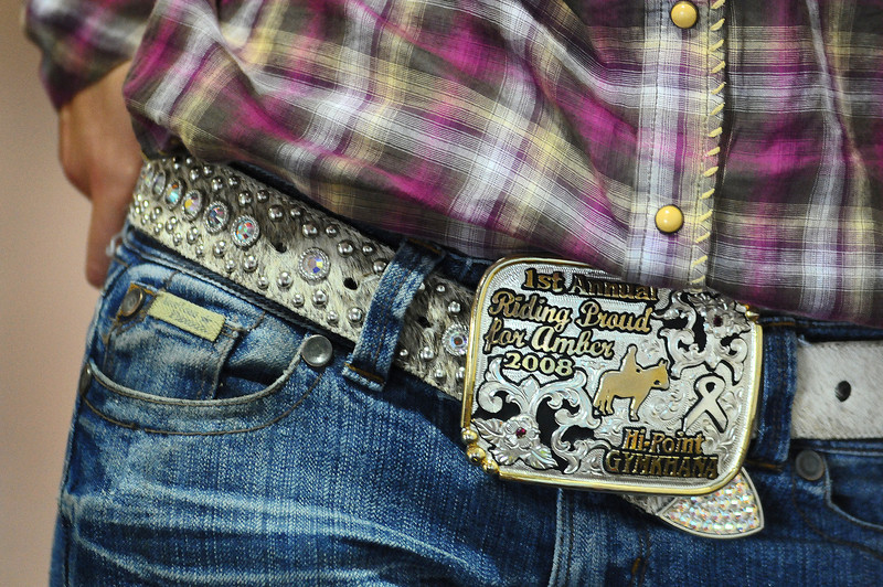 Bailey Neiberger, 13, of Loveland won her favorite belt buckle in a benefit for a girl who had brain cancer.