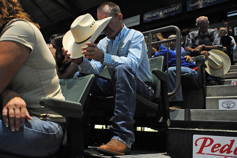 Marv Nelson of Ault pauses for prayer during Cowboy Church on Sunday at The Ranch.