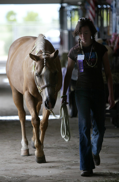 Paige Melby, 15, from Loveland walks her horse Misty to the Ranchway Feeds Indoor Arena to practice.