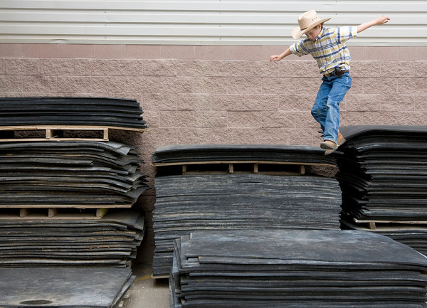 Cole Hooker, 7, from Fort Collins, jumps off mats behind the Ranchway Feeds Indoor Arena.