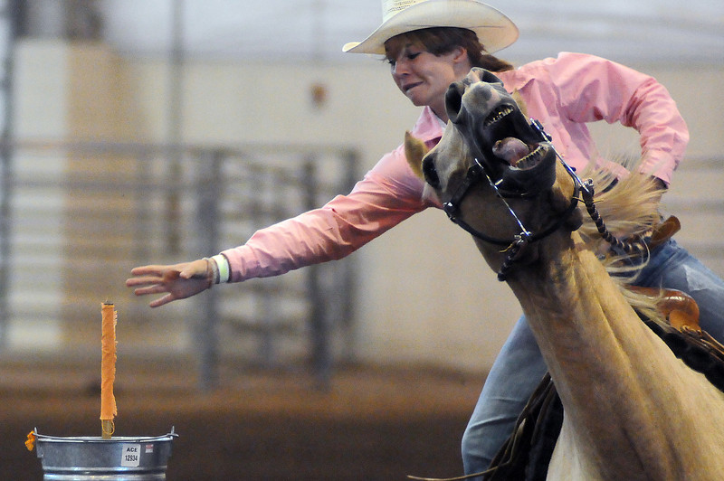Victoria Warren of Loveland stretches for a flag in the flag event during the Junior Rodeo on Sunday at The Ranch.